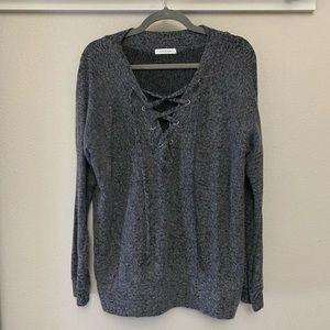 Super soft lace up sweater.